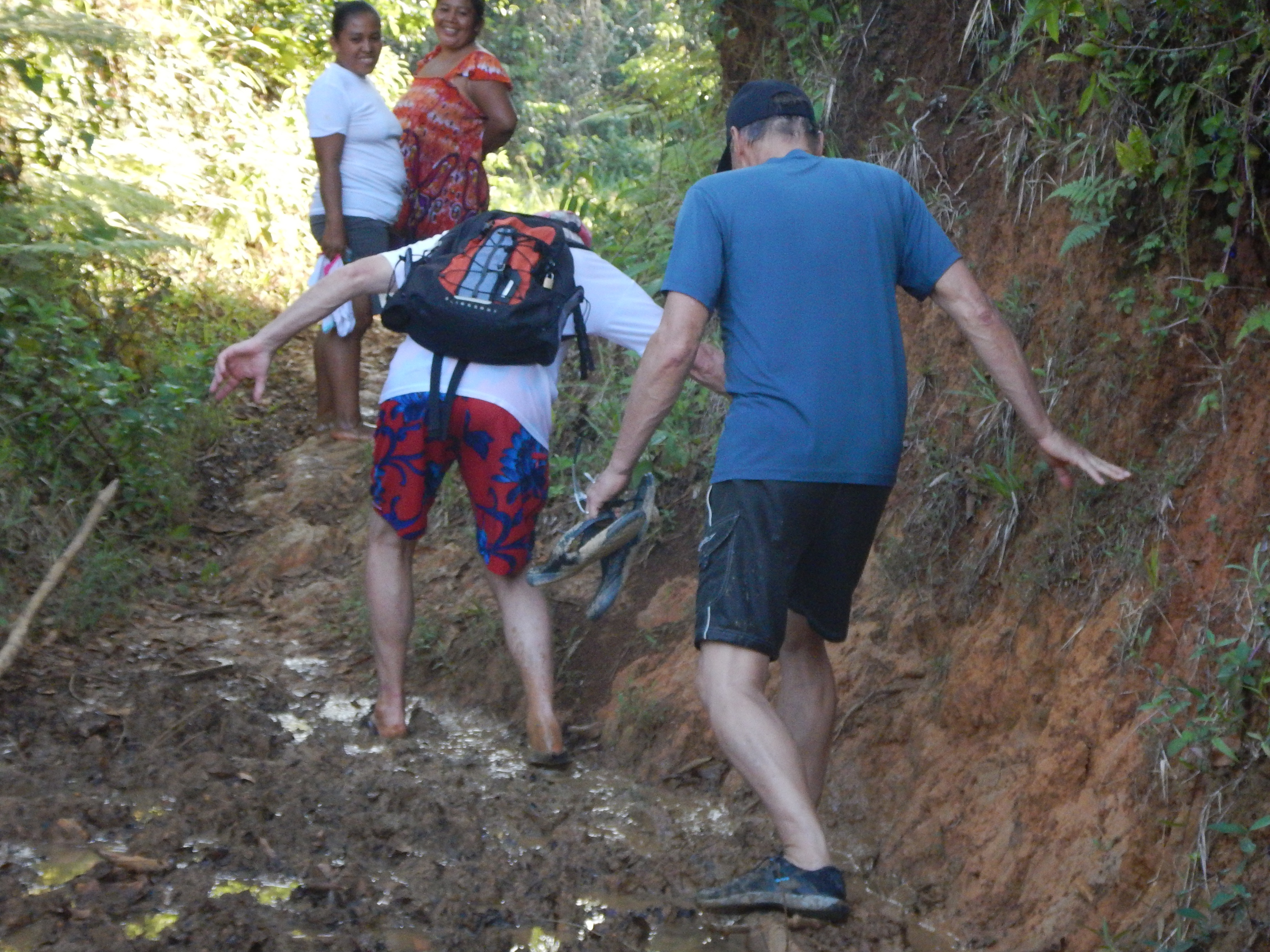The barefoot locals had a good laugh over gringoes who got their fancy shoes stuck in the mud.
